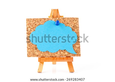 Wooden easel with corkboard and blue speech bubble isolated on white background - stock photo