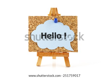 Wooden easel with corkboard and blue speech bubble with word Hello! isolated on white background - stock photo