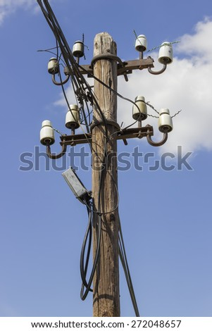 Wooden electrical pole with telephone lines with sky background - stock photo