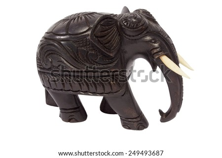 Wooden elephant figurine on a white background - stock photo