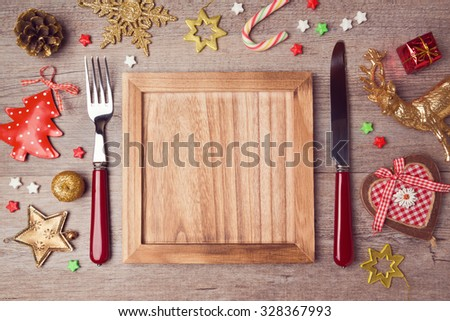 Wooden empty plate with rustic Christmas decorations. Menu background - stock photo