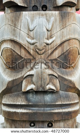 wooden face on totem - stock photo