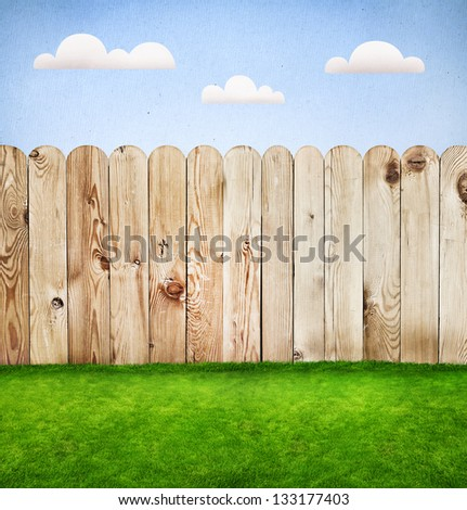 Wooden fence in a green grass, template design - stock photo