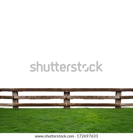 wooden fence in green grass meadow - stock photo