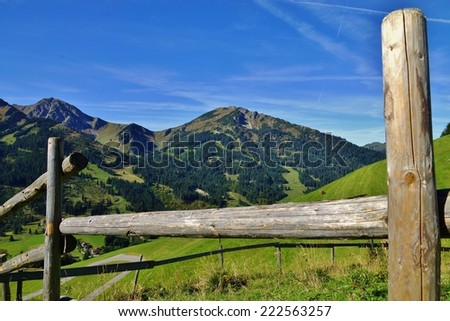 Wooden Fence in the Alps - stock photo