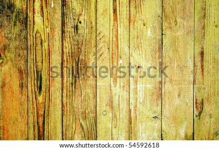Wooden fence on all background, with traces of a paint. - stock photo
