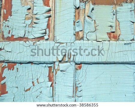 Wooden fence with cracks on a paint - stock photo