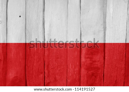 Wooden fence with the flag of Poland painted on it - stock photo