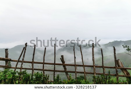 wooden fence,wooden fence Mountain atmosphere morning,morning,white mist in the morning,beautiful wooden  fence,  - stock photo