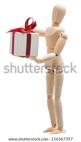 wooden figure dummy mannequin holding a gift box tied with a red ribbon isolated on white background - stock photo