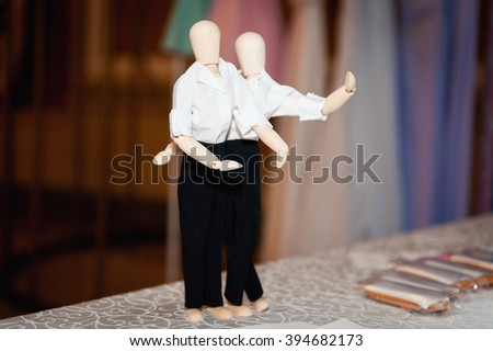 Wooden figures embracing together on the table. - stock photo