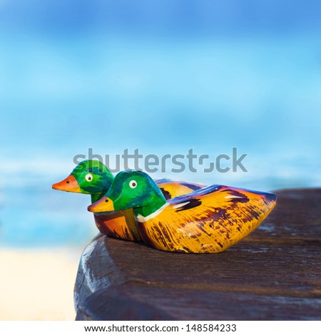 wooden figurines mandarin duck   - stock photo
