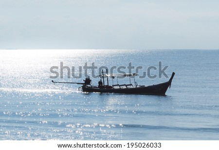 wooden fisherman boat at blue background - stock photo