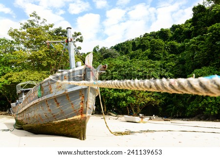 Wooden fishery boat ship wreck - stock photo