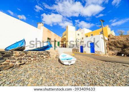 Wooden fishing boats in a small port in El Tarajalejo in Canary Islands - stock photo