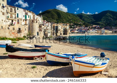 wooden fishing boats on the old beach of Cefalu, Sicily - stock photo