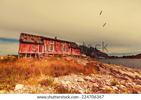 wooden fishing cabin in   Norway - stock photo
