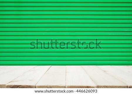 Wooden floor and old steel door. Steel texture. Steel pattern. Steel wall. - stock photo