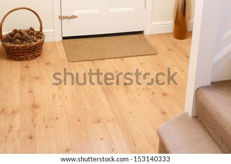 Wooden floor in entrance hall - stock photo