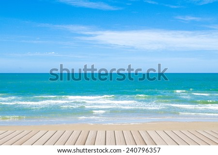 wooden floor on beach and sea with blue sky - stock photo