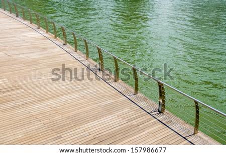 Wooden floor on riverbank - stock photo