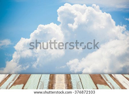 wooden floor with  nature background of cloudy  blue sky  - stock photo