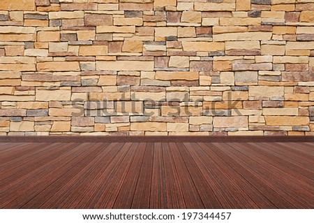 Wooden floor with stone wall - empty room background - stock photo