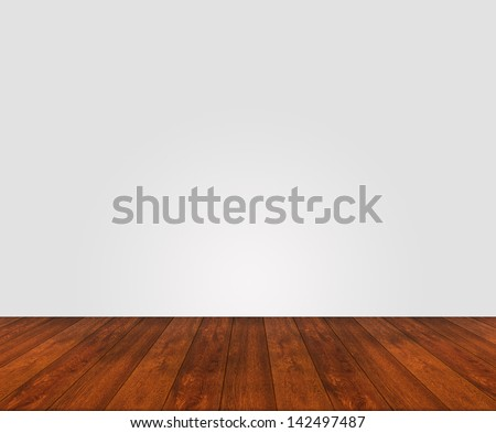 wooden floor with white painted unstructured wall - stock photo