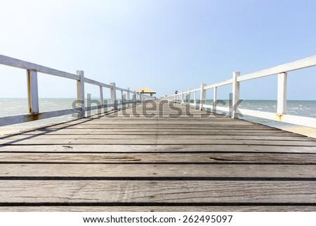 Wooden footbridge low view in seascape - stock photo