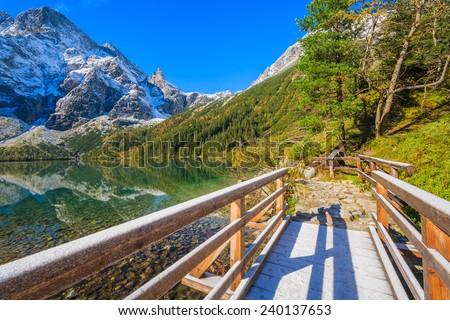 Wooden footbridge near Morskie Oko lake in autumn season, Tatra Mountains, Poland - stock photo