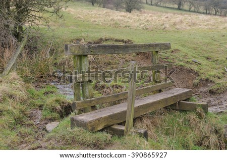 Wooden Footbridge over Bletch Brook, near the Rural Village of Tissington, within the Peak District National Park, Devon, England, UK - stock photo