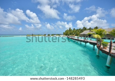 Wooden footbridge over the tropical island  - stock photo