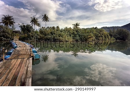 Wooden footbridge to the island of Koh Chang, Thailand - stock photo
