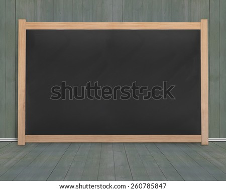 Wooden frame of blank blackboard with dark green wood wall and floor background - stock photo