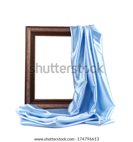 Wooden frame with blue silk. On a white background. - stock photo