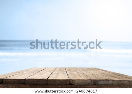 wooden free space on table and summer sea landscape and sun  - stock photo