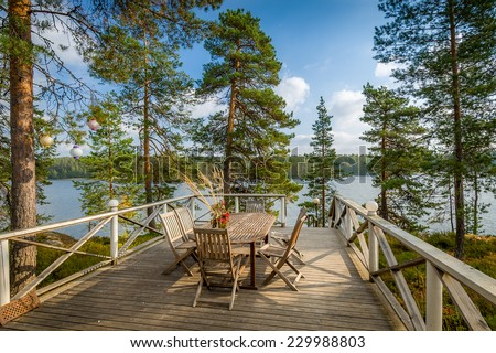 Wooden furniture table and chairs in the nature environment - stock photo