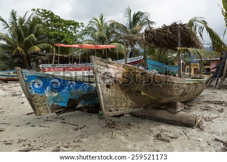 wooden garifuna fishing boats in Sambo Creek  Honduras  - stock photo