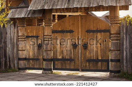 wooden gate, cutting wood - stock photo
