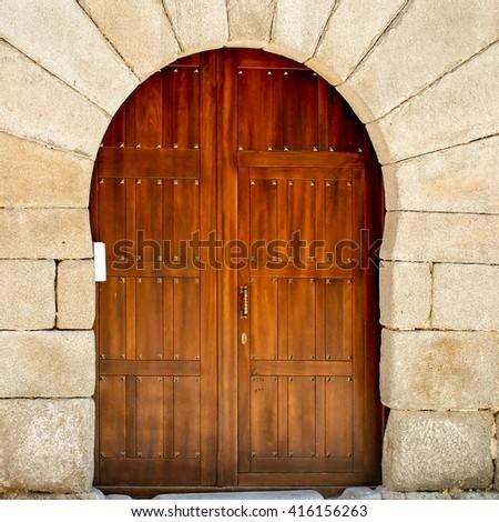 Wooden gate in Segovia, Spain - stock photo