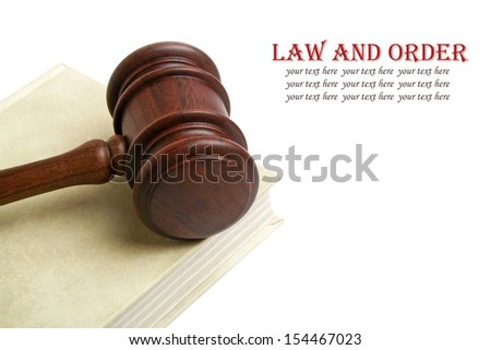 Wooden gavel and book on white background - stock photo