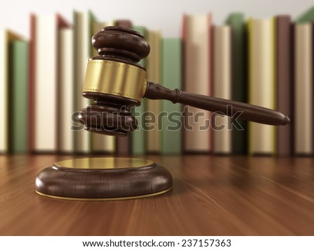 Wooden gavel and books on wooden table. - stock photo