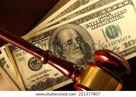 Wooden gavel and dollar banknotes - stock photo