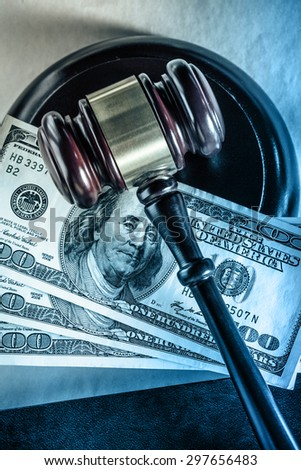 Wooden gavel and dollar banknotes in closeup - stock photo
