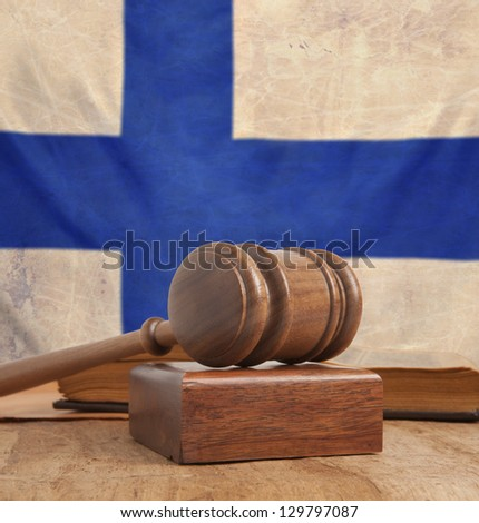 Wooden gavel and vintage Finland flag - stock photo