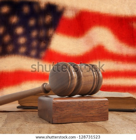 Wooden gavel and vintage USA flag - stock photo
