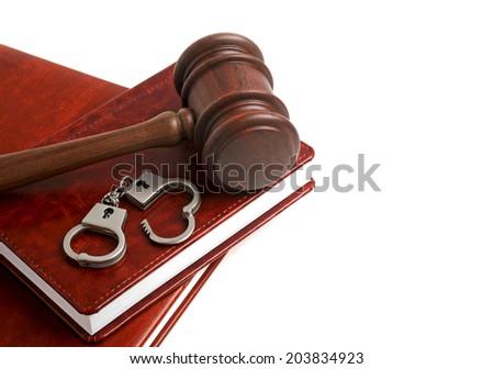 Wooden gavel, handcuffs and books, isolated on white background - stock photo