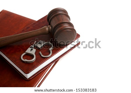 Wooden gavel, notebook and handcuffs, isolated on white background - stock photo