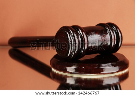 Wooden gavel on brown background - stock photo
