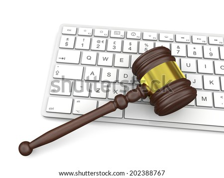 Wooden gavel on computer keyboard, symbol of law and justice in technology - stock photo